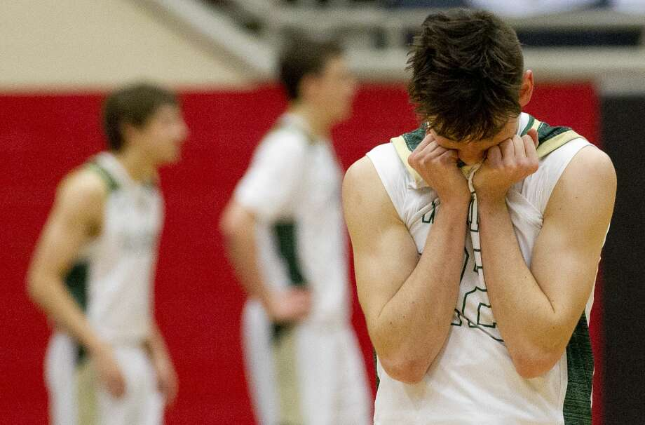 The Woodlands Christian Academy shooting guard Zack Golaszewski (22) reacts in the closing seconds of overtime during the TAPPS 4A state championship game at West High School, Friday, March 1, 2019, in West. Arlington Grace Prep defeated TWCA 58-54 in overtime. Photo: Jason Fochtman/Staff Photographer