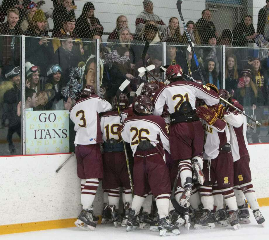 Members of the Sheehan hockey team celebrate their SCC Division 3 championship Friday, March 1, 2019 at Bennett Rink. Sheehan defeated JBWA 10-1. Photo: John Vanacore / For Hearst Connecticut Media / (c)John H.Vanacore