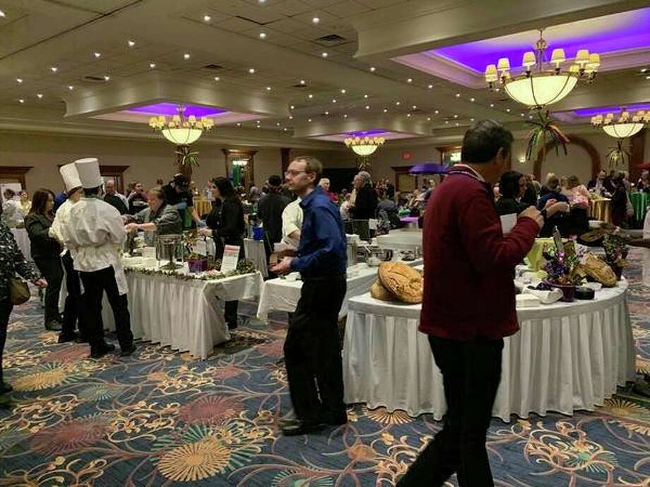 Patrons enjoy a Mardi Gras-themed dinner during The Legacy Center for Community Success' annual fundraiser on Feb. 28, 2019,Great Hall Banquet & Convention Center, in Midland. (Mitchell Kukulka/Mitchell.Kukulka@mdn.net)