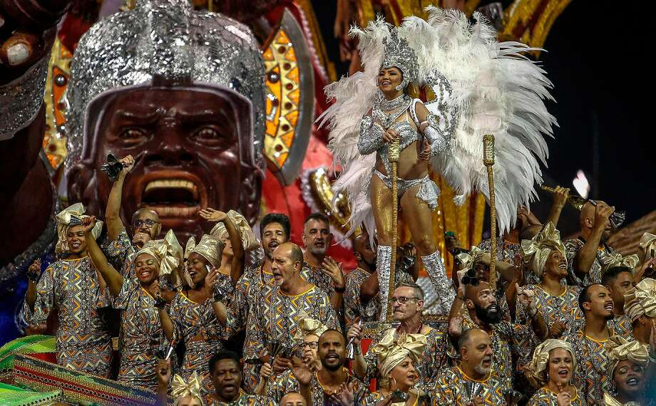A member of the X9-Paulistana samba school performs during Carnival festivities in Sao Paulo. Many revelers targeted new President Jair Bolsonaro. Photo: Miguel Schincariol / AFP / Getty Images