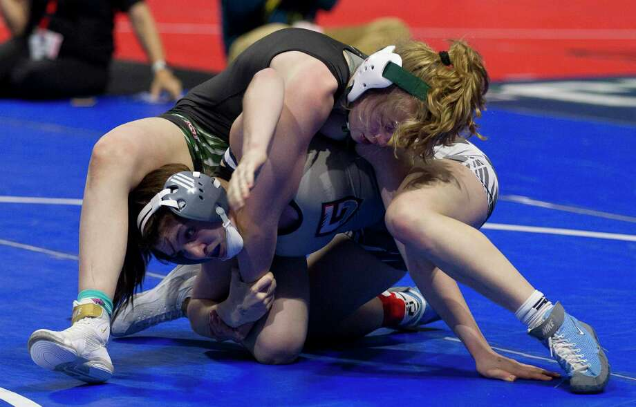 Maddie Sandquist of Kingwood Park competes against Mea Mohler of Leander Glenn in a Class 5A girls 128-pound bout during the UIL State Wrestling Championships at the Berry Center, Saturday, Feb. 23, 2019, in Cypress. Photo: Jason Fochtman, Houston Chronicle / Staff Photographer / © 2019 Houston Chronicle