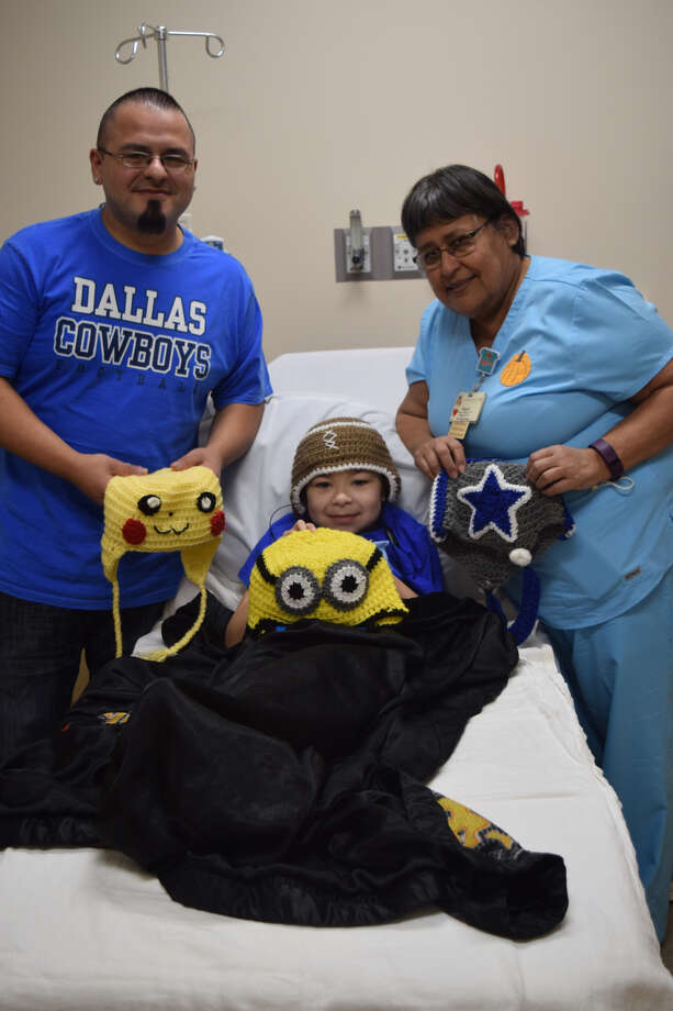 Above, Jose Galvan, son, Jaydin and Covenant Health Plainview nurse Raquel Villarreal, LVN, show off hats crocheted by the nurse for the 10-year-old. Photo: Homer Marquez/Covenant Health Plainview