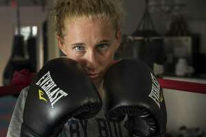 In the gym and in the ring, it's blood, sweat and dirt for Ginny Fuchs and that's OK. Outside the ring, she deals with the fear of contamination and germs.