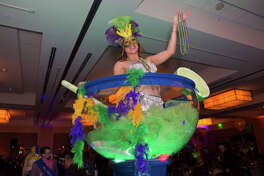 Formal attire, masks and beads set the tone for the Mardi Gras-themed Royal Masquerade Gala on Friday, March 1, at the Hyatt Regency.
