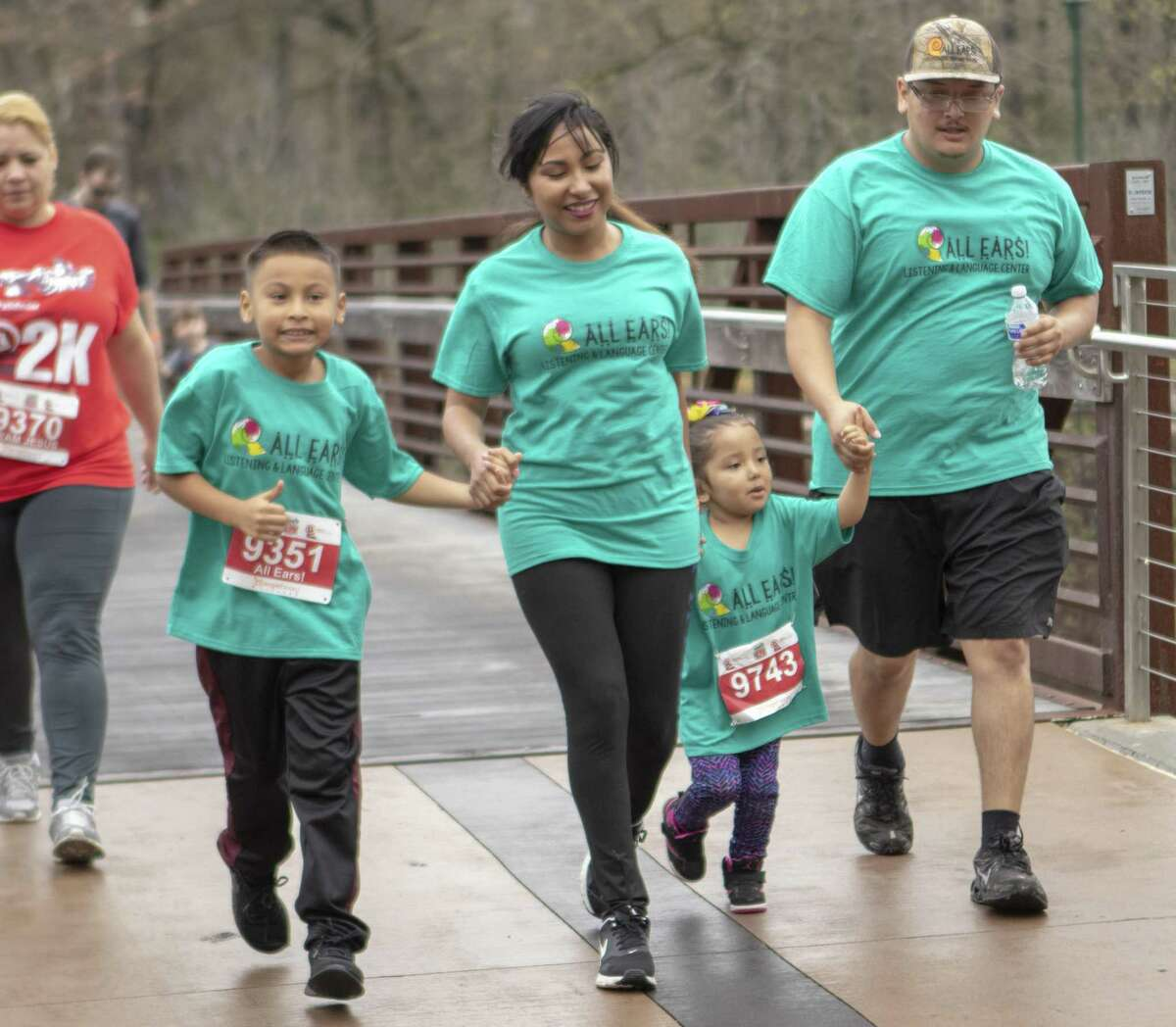 Runners from All Ears! cross over The Woodlands Waterway during The Woodlands Marathon 2K Fun Run/Walk on Saturday, Feb. 23, 2019 in The Woodlands.