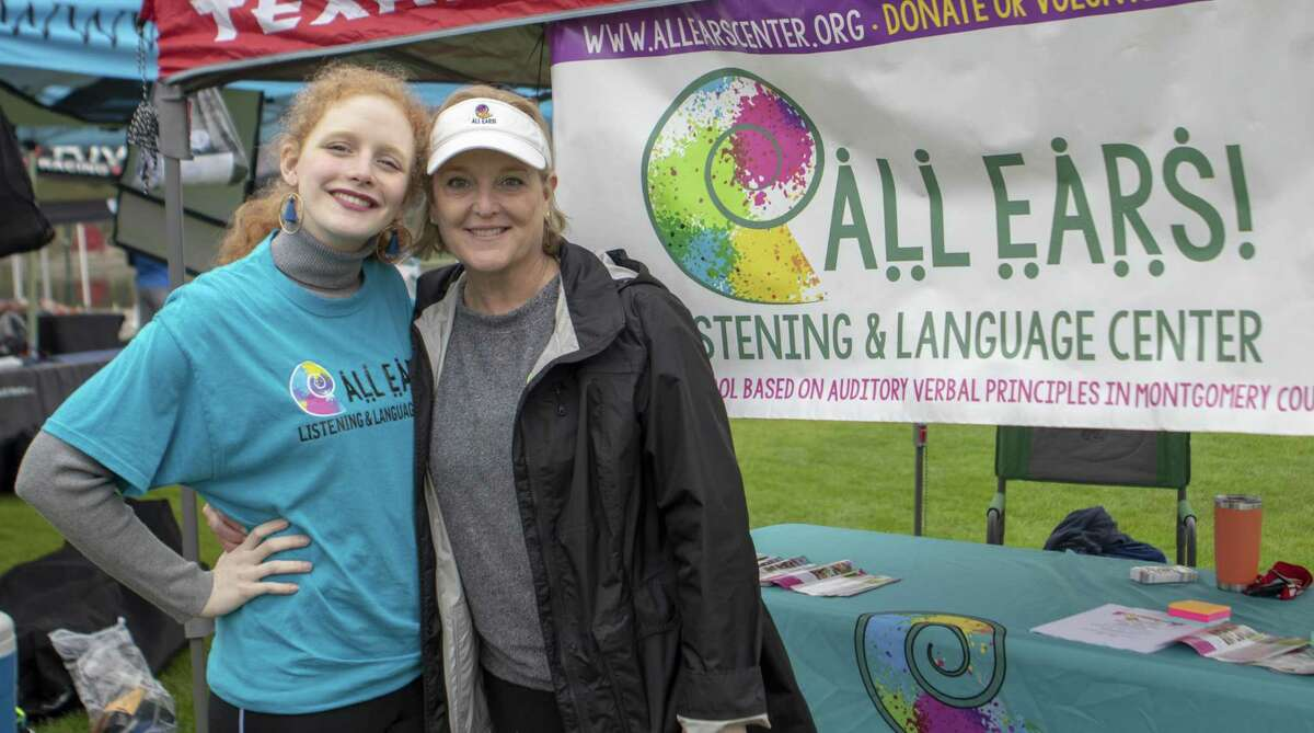 Anna Rech and her mother Lee Rech stand near the All Ears! Listening and Language Center tent during The Woodlands Marathon on Saturday, March 2, 2019 in The Woodlands.