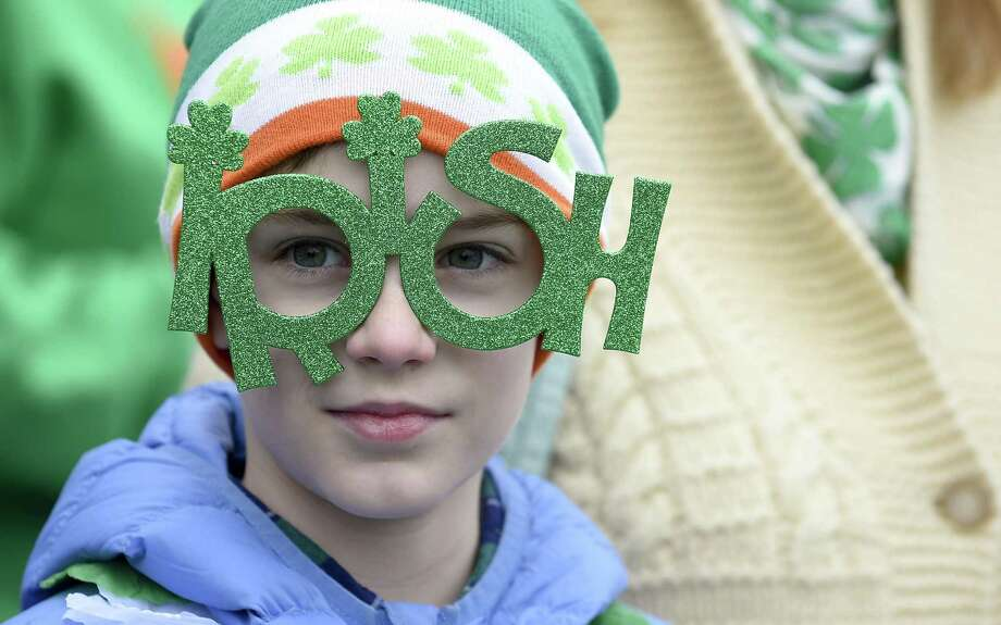 Grady Zezima, 9, of Stamford sports a pair of Irish Glasses while watching the City of Stamford's Annual St. Patrick's Day Parade on Saturday, March 2, 2019 in Stamford, Connecticut. Photo: Matthew Brown / Hearst Connecticut Media / Stamford Advocate