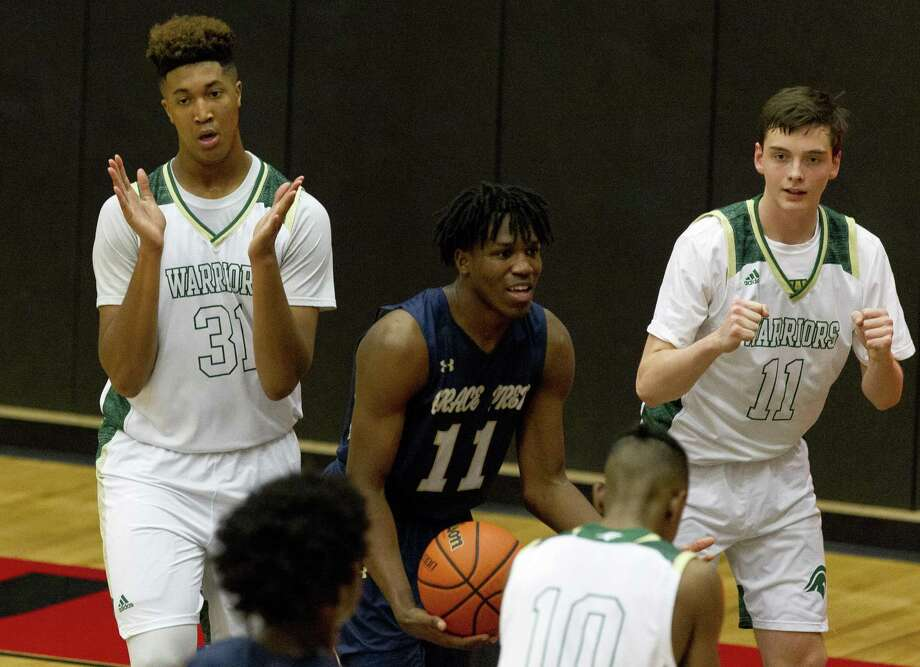 The Woodlands Christian Academy center Emanuel Jones (31) and shooting guard Nash Golaszewski (11) react after a turnover by Arlington Grace Prep forward Myles McCrary (11) during the third quarter of the TAPPS 4A state championship game at West High School, Friday, March 1, 2019, in West. Arlington Grace Prep defeated TWCA 58-54 in overtime. Photo: Jason Fochtman, Houston Chronicle / Staff Photographer / © 2019 Houston Chronicle