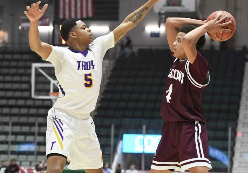 Troy's Lateef Johnson guards Gloversville's Julien Deumaga during the Class A sectional final at Cool Insuring Arena in Glens Falls, N.Y. on Saturday, Mar. 2, 2019. (Jenn March, Special to the Times Union )
