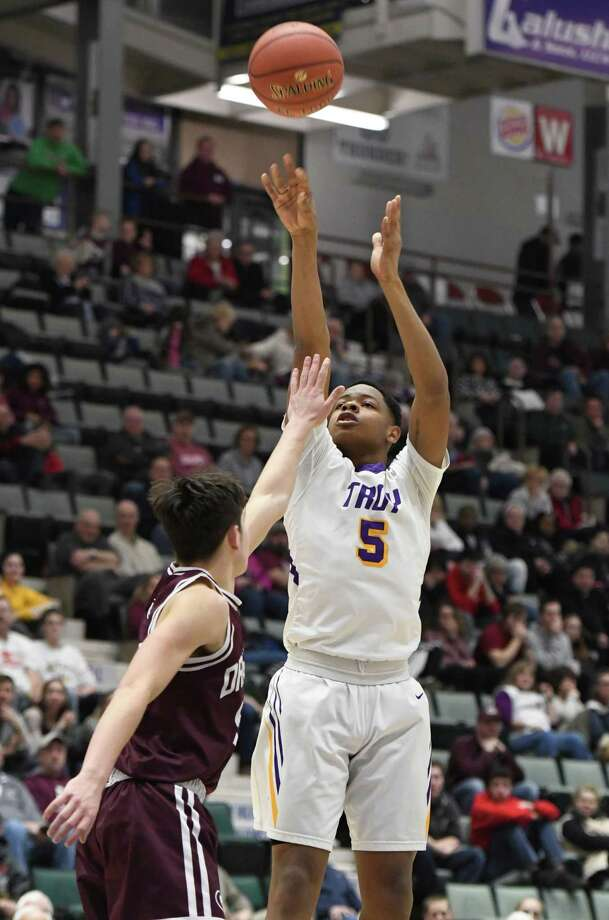 Troy's Lateef Johnson takes a shot over Gloversville's Joey Rowback during the Class A sectional final at Cool Insuring Arena in Glens Falls, N.Y. on Saturday, Mar. 2, 2019. (Jenn March, Special to the Times Union ) Photo: Jenn March, Jenn March Photography / © Jenn March 2018 © Albany Times Union 2018