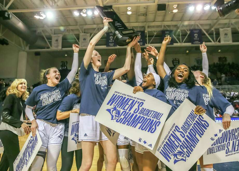 March 2, 2019:  Rice Owls players celebrate after defeating the Louisiana Tech Techsters 78-42 becoming C-USA champions at Tudor Fieldhouse in Houston, Texas. Photo: Leslie Plaza Johnson, Contributor / Houston Chronicle