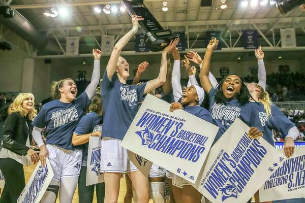 March 2, 2019: Rice Owls players celebrate after defeating the Louisiana Tech Techsters 78-42 becoming C-USA champions at Tudor Fieldhouse in Houston, Texas.