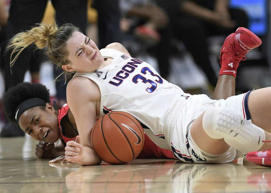 UConn's Katie Lou Samuelson, top and Houston's Julia Blackshell-Fair fall to the court chasing a loose ball during the first half on March 2 in Storrs. Samuelson left the game injured after the play. Photo: Jessica Hill / Associated Press / Copyright 2019 The Associated Press. All rights reserved