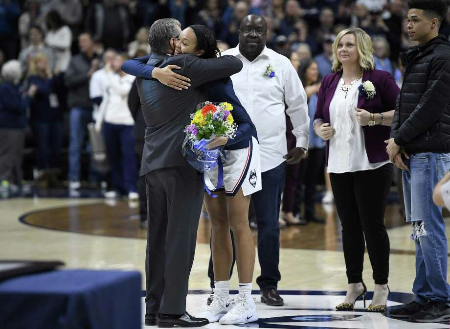 UConn senior Napheesa Collier embraces head coach Geno Auriemma during senior day before an NCAA game against Houston on Saturday in Storrs. Photo: Jessica Hill / Associated Press / Copyright 2019 The Associated Press. All rights reserved