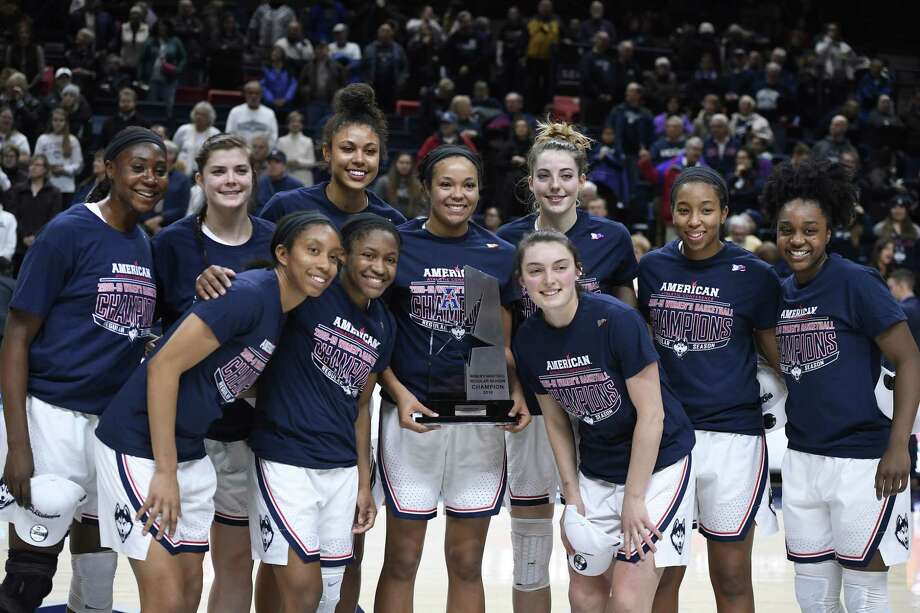 The UConn's women's basketball team poses with the American Athletic Conference trophy after a win over Houston on March 2 in Storrs. Photo: Jessica Hill / Associated Press / Copyright 2019 The Associated Press. All rights reserved