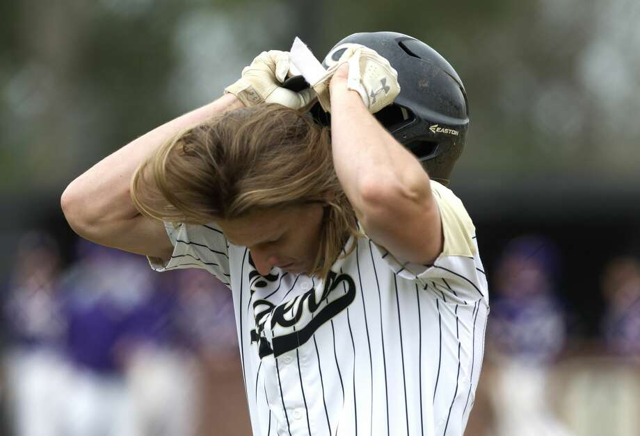 Hayden Johnson #19 of Conroe reacts after grounding out  in the fourth inning of a high school baseball game during the Ferrell Classic, Saturday, March 2, 2019, in Conroe. Jersey Village defeated Conroe 5-1. Photo: Jason Fochtman/Staff Photographer