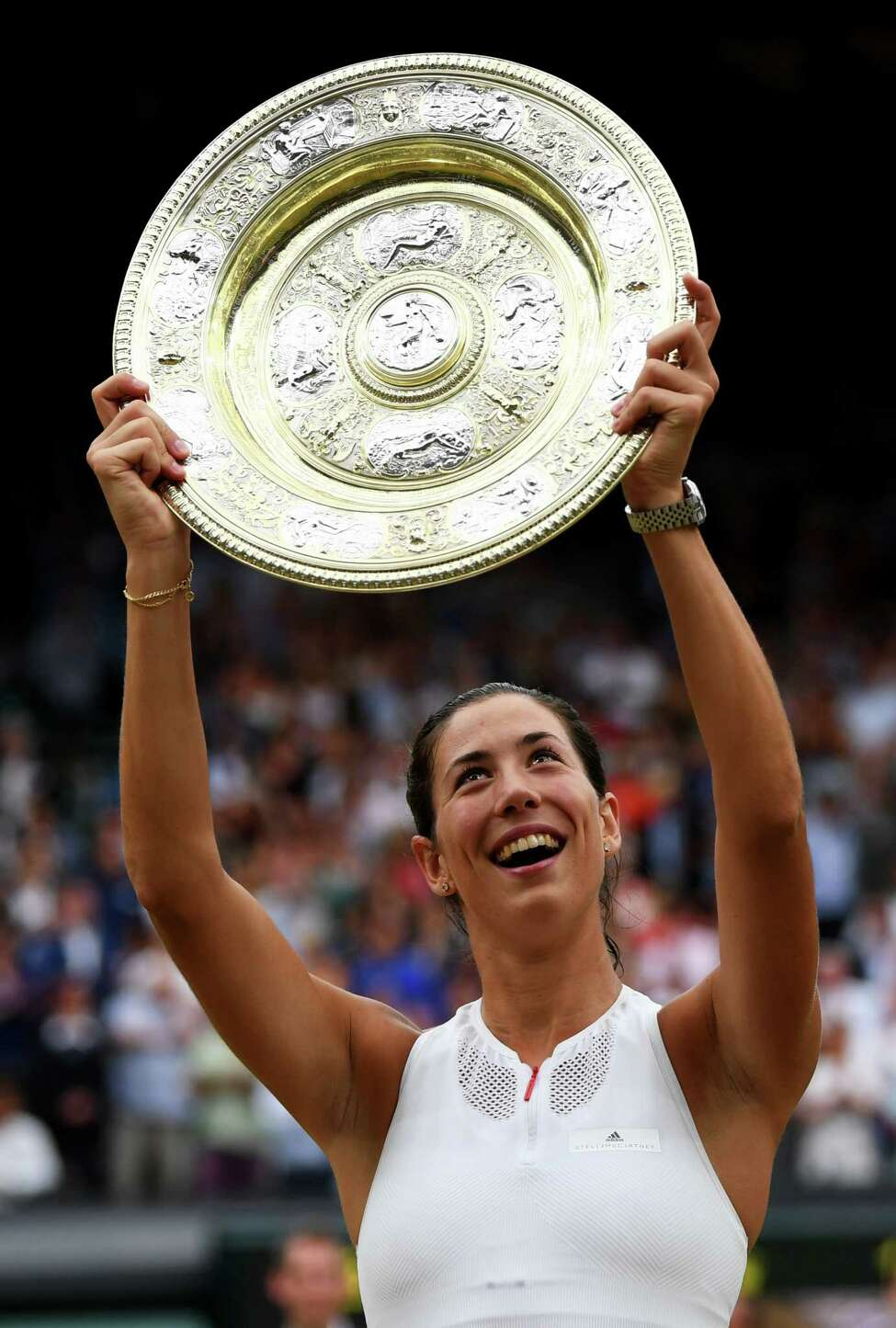 *** BESTPIX *** LONDON, ENGLAND - JULY 15: Garbine Muguruza of Spain celebrates victory with the trophy after the Ladies Singles final against Venus Williams of The United States on day twelve of the Wimbledon Lawn Tennis Championships at the All England Lawn Tennis and Croquet Club at Wimbledon on July 15, 2017 in London, England. (Photo by Shaun Botterill/Getty Images) ORG XMIT: 700042013