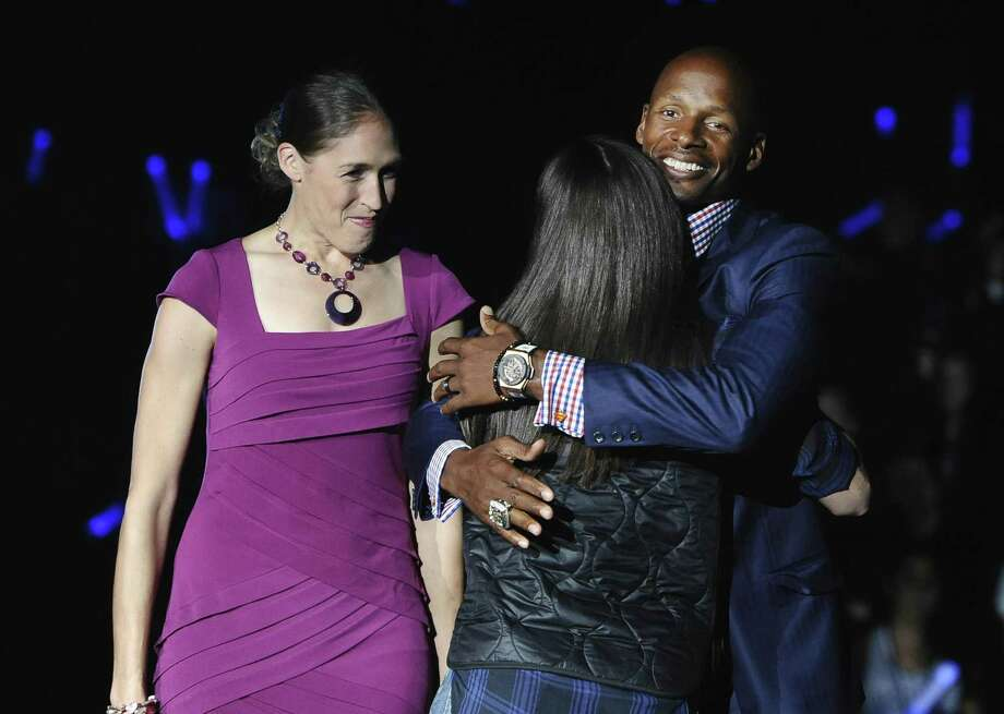 Ray Allen, right, hugs Sue Bird as Rebecca Lobo, left, watches at UConn's First Night event in October 2014 in Storrs. Photo: Jessica Hill / Associated Press / Associated Press
