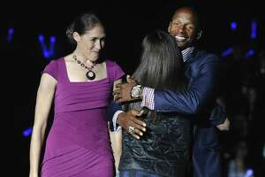 Ray Allen, right, hugs Sue Bird as Rebecca Lobo, left, watches at UConn's First Night event in October 2014 in Storrs.