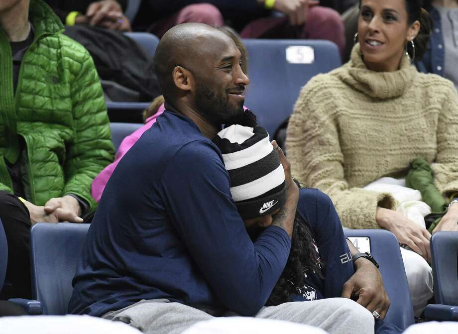 Kobe Bryant and his daughter Gianna watch the first half between Connecticut and Houston on Saturday in Storrs. Photo: Jessica Hill / Associated Press / Copyright 2019 The Associated Press. All rights reserved