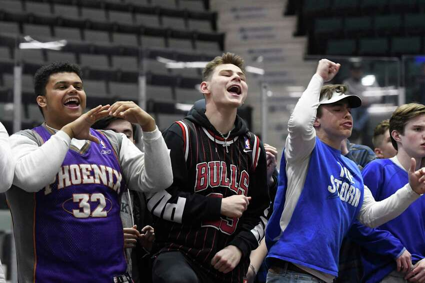Saratoga basketball fans cheer after a basket is made during the Class AA boys basketball sectional final against Bethlehem at Cool Insuring Arena in Glens Falls, N.Y. on Saturday, Mar. 2, 2019. (Jenn March, Special to the Times Union )