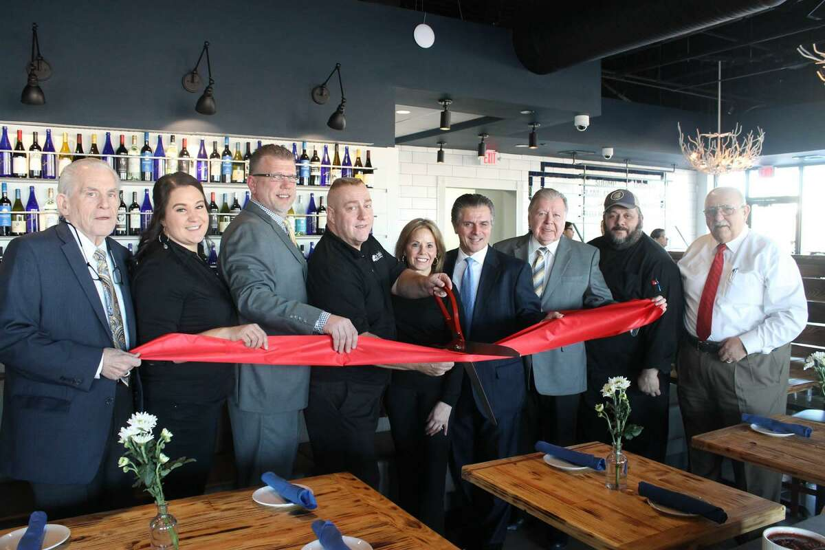 Brizo Fish had a grand opening at 945 Cromwell Ave., Rocky Hill. From left are Chamber President Larry McHugh, bartender Amanda Fromerth, Cromwell Division Chair Rodney Bitgood, Owner Francis DelMastro, event coordinator/community relations at Brizo Restaurant Suzanne Arborio, Tim Arborio, Chairman Jay Polke, Chef Joe DeLucia and Town Manager Anthony Salvatore.
