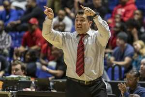North Shore head coach Sam Benitez calls out a play from the sidelines in the second half of a UIL Class 6A Regional Final high school basketball game at Berry Center on Saturday, Mar 2, 2019, in Cypress, Texas.