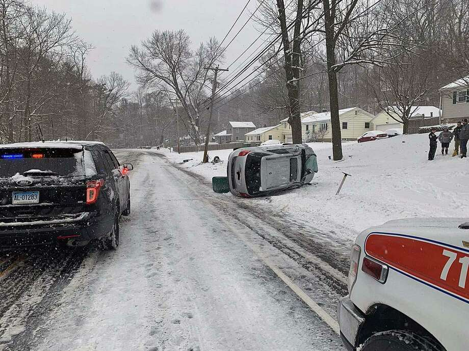 A rollover crash in Fairfield, Conn., on March 2, 2019. Police said the driver was cited for driving too fast for conditions. Edits to the license plate were not made by Hearst Connecticut Media. Photo: Contributed Photo / Fairfield Police Department / Connecticut Post Contributed