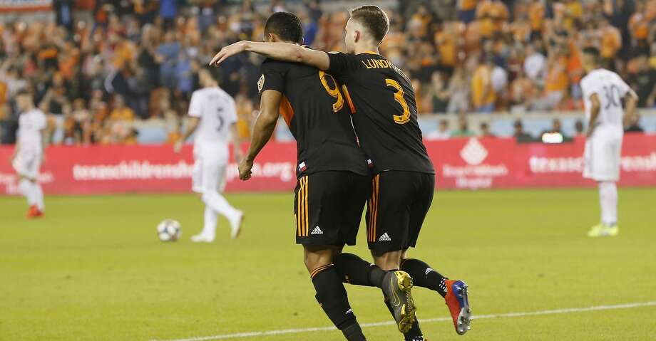 Houston Dynamo defender Adam Lundqvist (3) congratulates forward Mauro Manotas (9) after scoring a goal in the second half during the MLS game between the Real Salt Lake and the Houston Dynamo at BBVA Compass Stadium in Houston, TX on Saturday, March 2, 2019.   The game ended with a score of 1-1. Photo: Tim Warner/Contributor