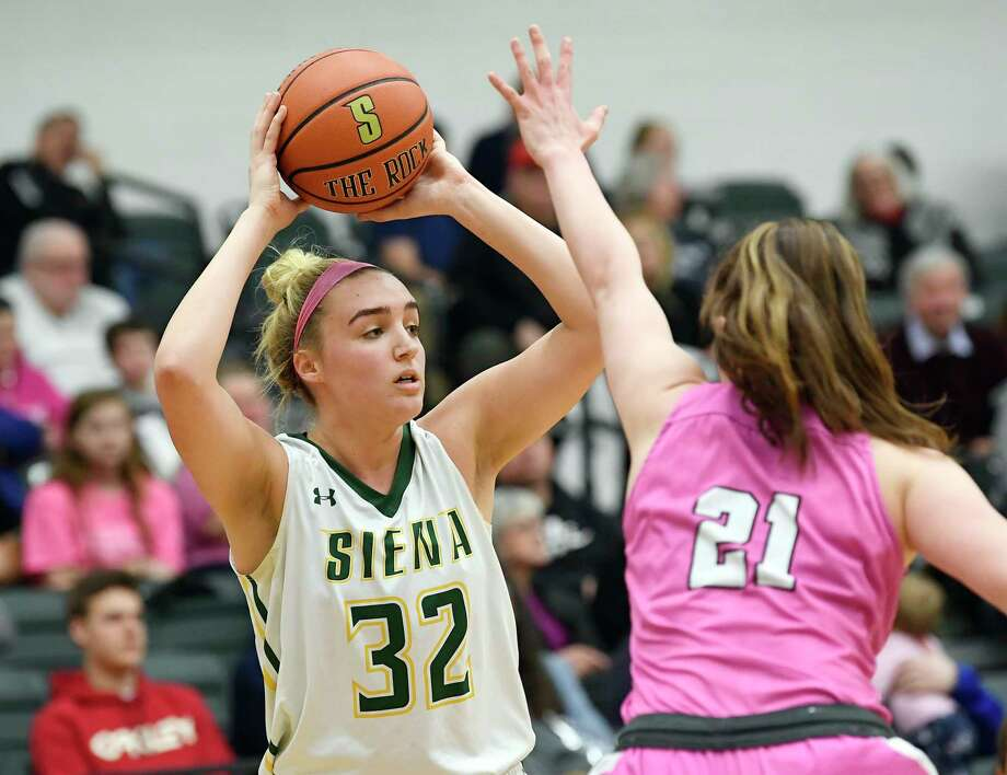 Siena forward Maddie Sims (32) looks to pass the ball against Marist forward Willow Duffell (21) during the first half of an NCAA women's college basketball game Friday, Feb. 1, 2019, in Loudonville, N.Y. (Hans Pennink / Special to the Times Union) Photo: Hans Pennink / 40046056A