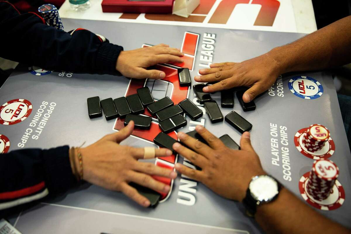 Players shuffle the dominos at the start of a match at Houston Prime Classic Domino Tournament on March 02, 2019.