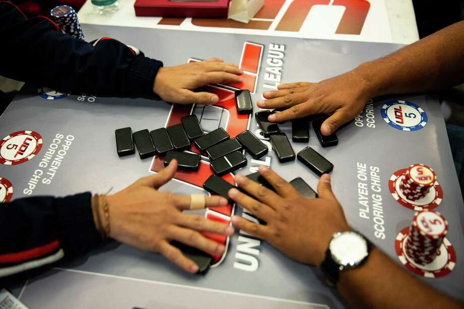 Players shuffle the dominos at the start of a match at Houston Prime Classic Domino Tournament on March 02, 2019. Photo: Pu Ying Huang, Contributor / Houston Chronicle