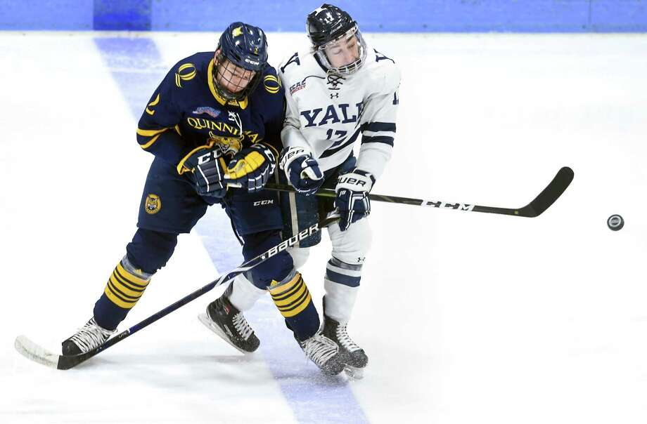 Quinnipiac's Karlis Cukste, left, and Yale's Kevin O'Neil collide in the first period at Ingalls Rink in New Haven on Saturday. Photo: Arnold Gold / Hearst Connecticut Media / New Haven Register