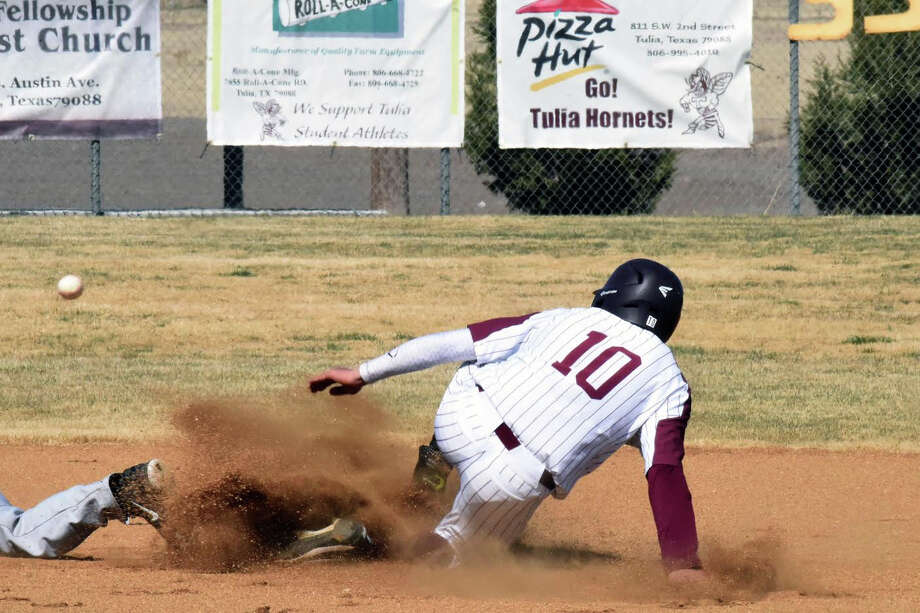 Tulia's Juan Carlos Pacheco slides into second base against Lockney during the Wood Bat Classic on Thursday in Tulia. The Hornets won/lost its host meet via an 11-0 decision against Dimmitt. Photo: Claudia Lusk/Plainview Herald