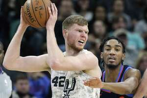 Davis Bertans posts up on Terrance Ferguson as the Spurs host the Thunder at the AT&T Center on March 2, 2019.