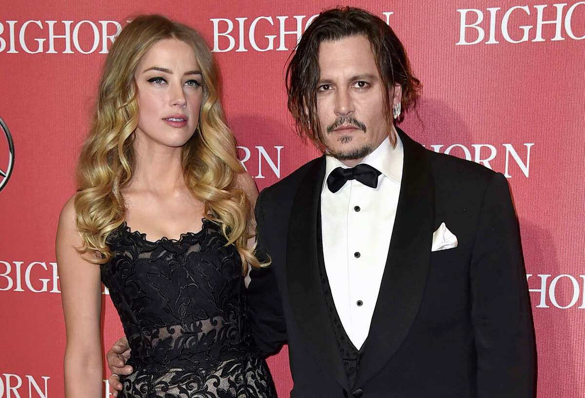 FILE - In this Jan. 2, 2016, file photo, Amber Heard, left, and Johnny Depp arrive at the 27th annual Palm Springs International Film Festival Awards Gala in Palm Springs, Calif. In a complaint filed Friday, March 1, 2019, Depp is suing his ex-wife Heard in a $50 million defamation lawsuit, citing a piece she wrote for The Washington Post about domestic abuse. (Photo by Jordan Strauss/Invision/AP, File)