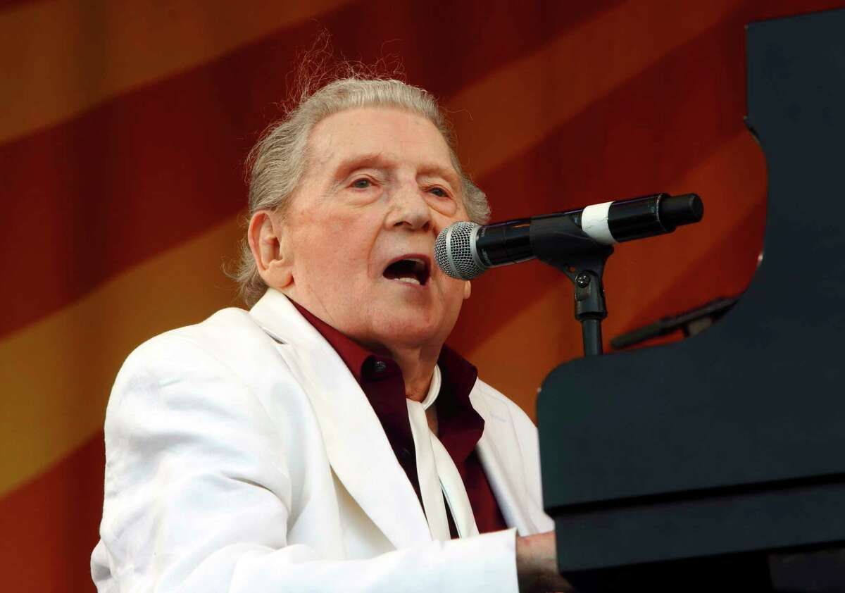 FILE - In this May 2, 2015 file photo, Jerry Lee Lewis performs at the New Orleans Jazz & Heritage Festival in New Orleans. Rock ?n? roll pioneer Lewis is recovering after a minor stroke, but he?s expected to make a full recovery. A statement from his publicist says the 83-year-old Rock & Roll Hall of Famer had the stroke Thursday night, Feb. 28, 2019, and is recuperating in Memphis. (Photo by John Davisson/Invision/AP, File)
