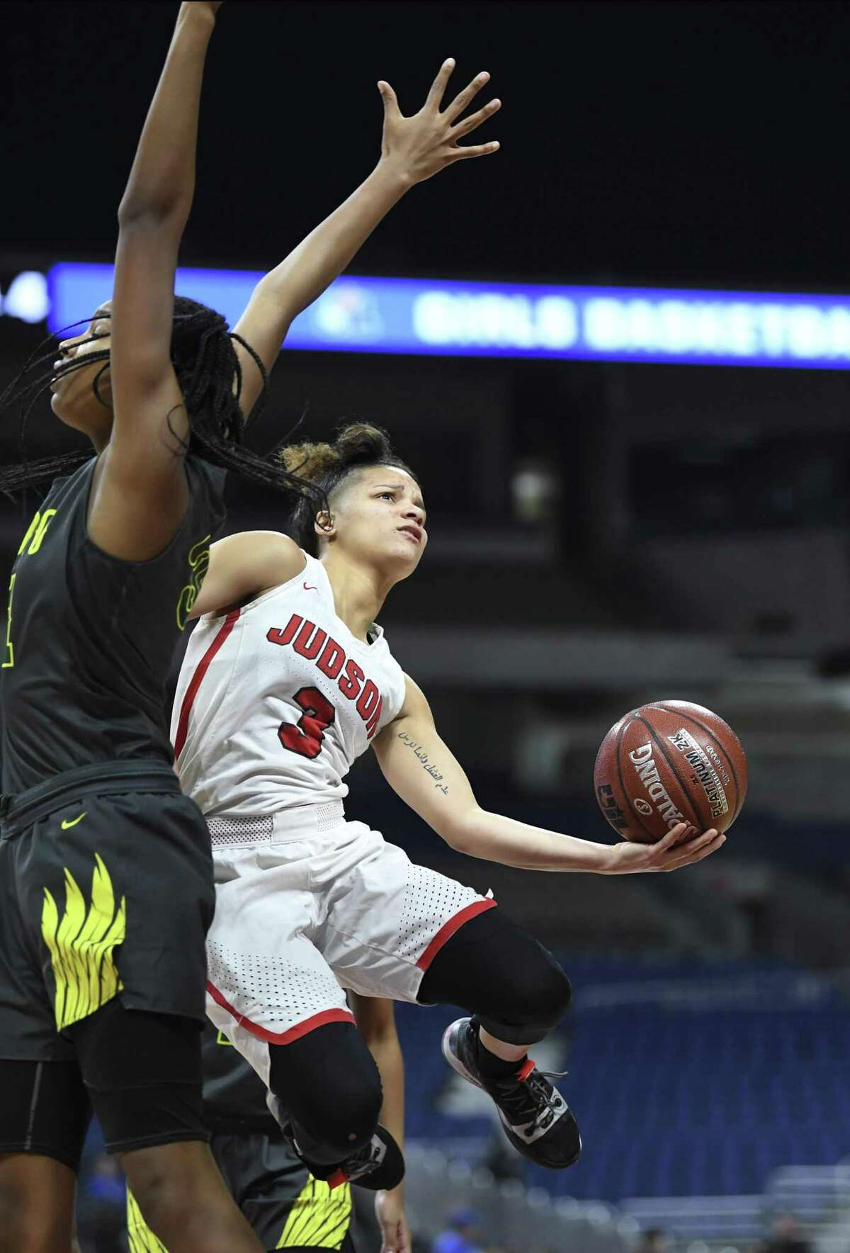 Judson's Corina Carter (3) penetrates and scores as Sa'Myah Smith of DeSoto defends during the Class 6A girls state championship game in the Alamodome on Saturday, March 2, 2019.
