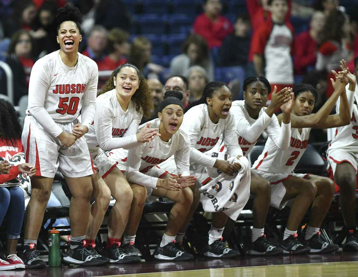 Ziya Brown (50) and teammates on the Judson bench celebrate during the Class 6A girls state championship game in the Alamodome on Saturday, March 2, 2019.