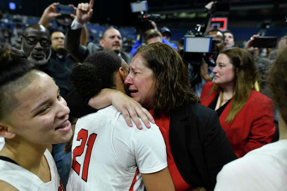 Judson head coach Triva Corrales cries after her Rockets beat DeSoto, 49-46, to win the Class 6A girls state championship game in the Alamodome on Saturday, March 2, 2019. Photo: Billy Calzada, Staff / Staff Photographer / San Antonio Express-News