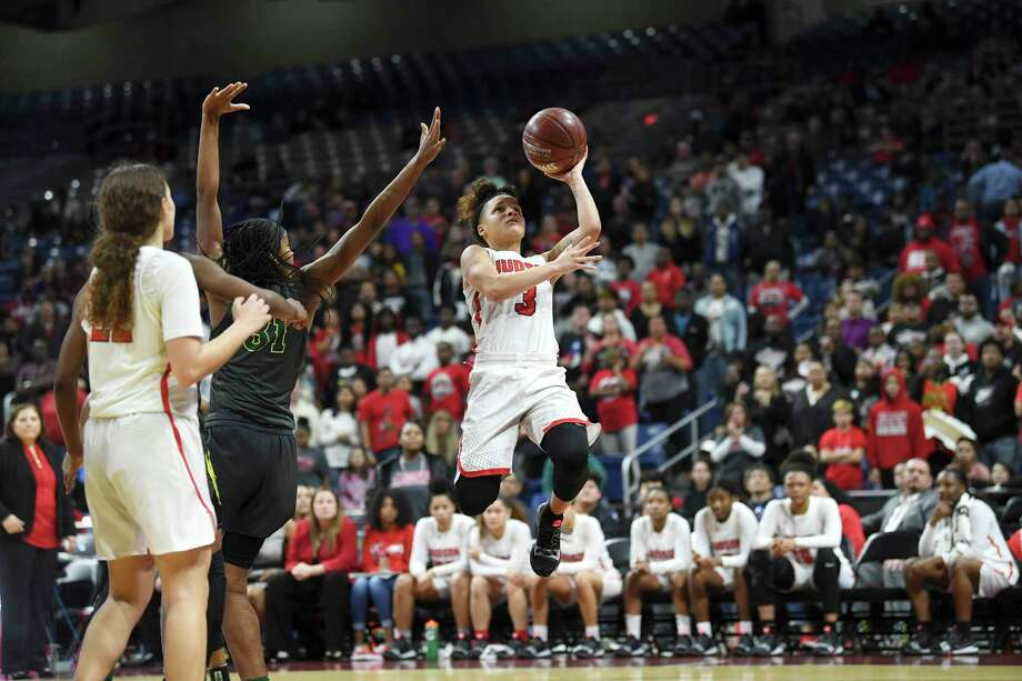 Judson's Corina Carter shoots and scores as time winds down on their victory over DeSoto in the Class 6A girls state championship game in the Alamodome on Saturday, March 2, 2019. Photo: Billy Calzada, Staff / Staff Photographer / San Antonio Express-News