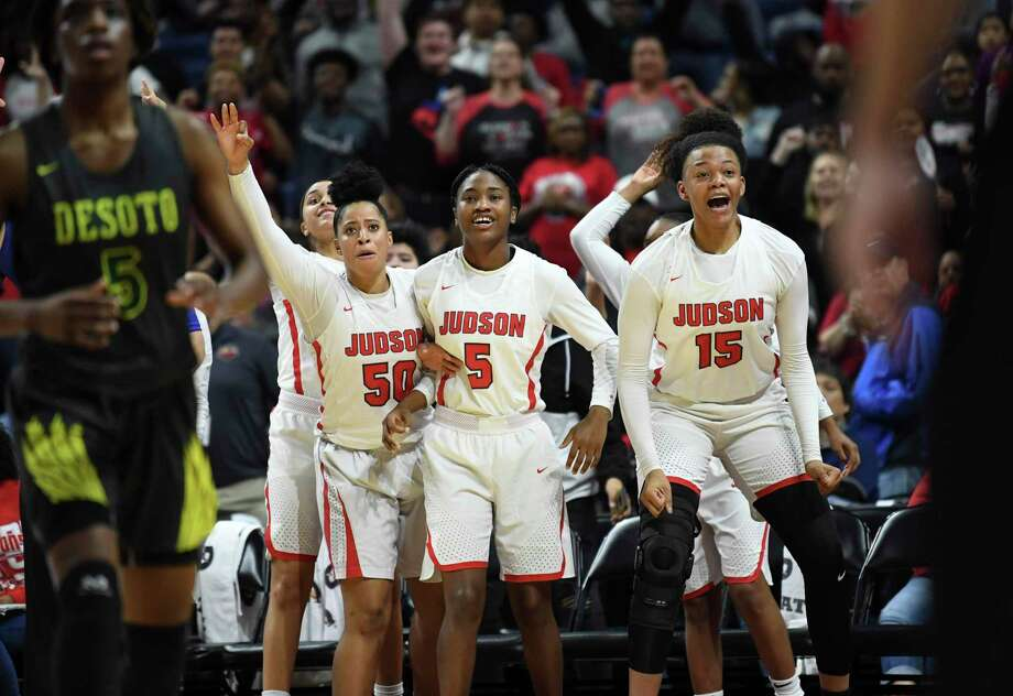 Ziya Brown, from left, Elisha Mackey and Elena Blanding celebrate in the final seconds of Judson's victory in the Class 6A state championship last season at the Alamodome. Photo: Billy Calzada /Staff Photographer / San Antonio Express-News