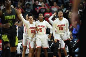 Ziya Brown, from left, Elisha Mackey and Elena Blanding celebrate in the final seconds of Judson's victory in the Class 6A state championship last season at the Alamodome.