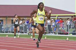 Alexander High School Cynthia Emeremnu leads in the Girls 200 Meter Dash on Saturday, Mar. 2, 2019, during the Border Olympics at the Student Activity Complex.