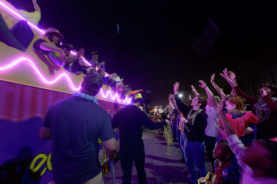 The crowd clamors for beads from passing floats during the Mardi Gras grand parade and festivities on Procter Street in Port Arthur Saturday. Photo taken Saturday, March 2, 2019 Kim Brent/The Enterprise Photo: Kim Brent/The Enterprise