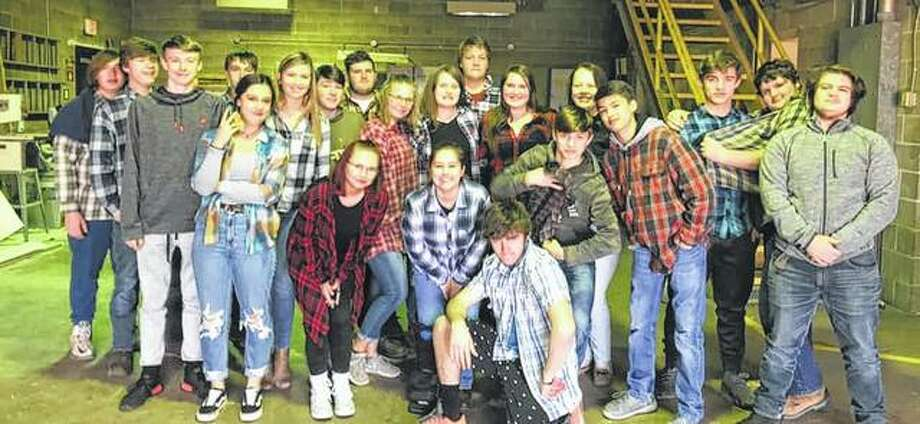 Members of the Bluffs FFA chapter recently celebrated FFA Week. The chapter had a different dress-up day each day of the week, and students participated in various games in their ag classes. The chapter also hosted its annual fun night one night and followed a couple of days later with its pork chop potluck. Photo: Photo Provided