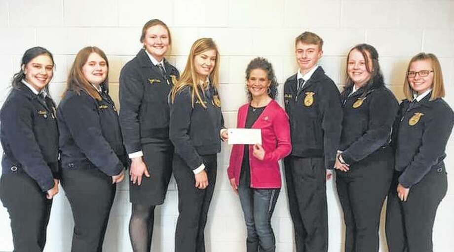 Farm Credit Illinois' Jacksonville office recently awarded $500 to the Bluffs FFA chapter. Jessica Freeman (fourth from right) of Farm Credit Illinois presented the award, telling the chapter's officers that Farm Credit is proud of the Bluffs chapter. FFA members on hand for the presentation included Kayde Gregory (from left), Madison Hopkins, Morgan Hoots, Alyssa Bartels, Ethan Buhlig, Ericka Huseman and Sydney Whicker. Photo: Photo Provided