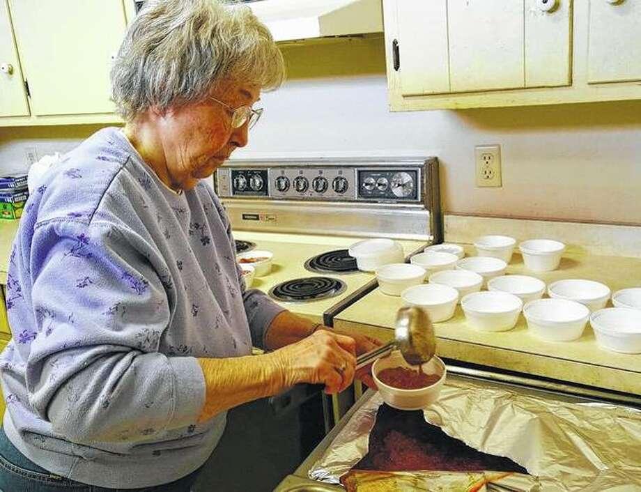 Vera Kirkpatrick prepares bowls of chili for Bread of Love lunches in Winchester.