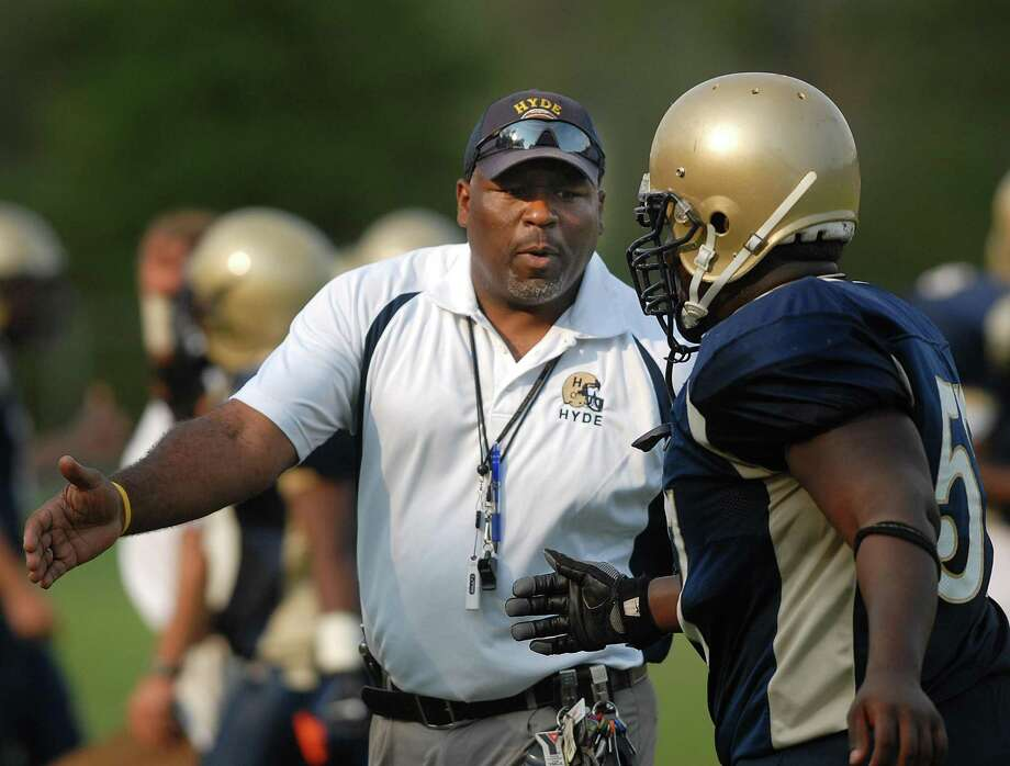 9/6/07 Photo-Casolino Cas070906 New Haven-- Hyde Coach Melvin Wells cheers on a player after a touchdown during the scrimmage against Harding.-Photo-Peter Casolino