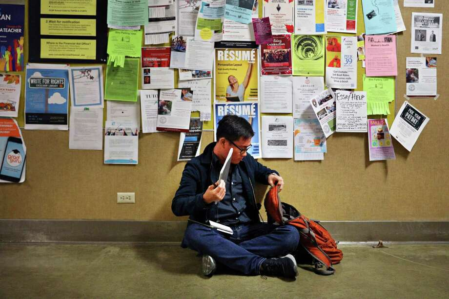 City College student Wayne Leong studies for his Bridge to Biotech final in the corridor in the Science Hall  on Tuesday, December 18,  2018  in San Francisco, Calif. Photo: File Photo / ONLINE_YES